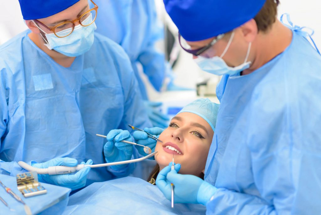 patient and dental team root canal specialist in new smyrna beach fl