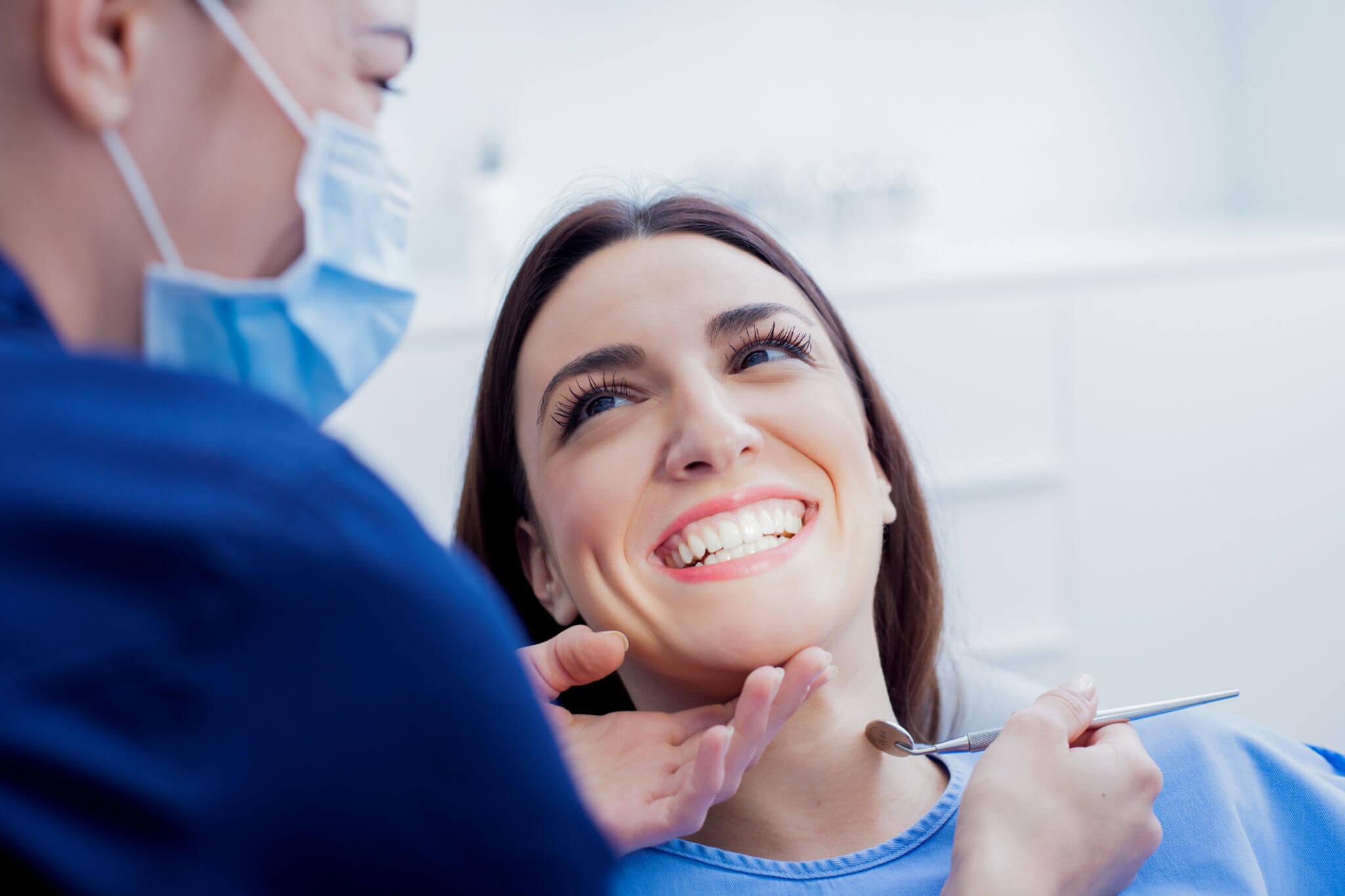 woman happy with teeth whitening in new smyrna beach fl