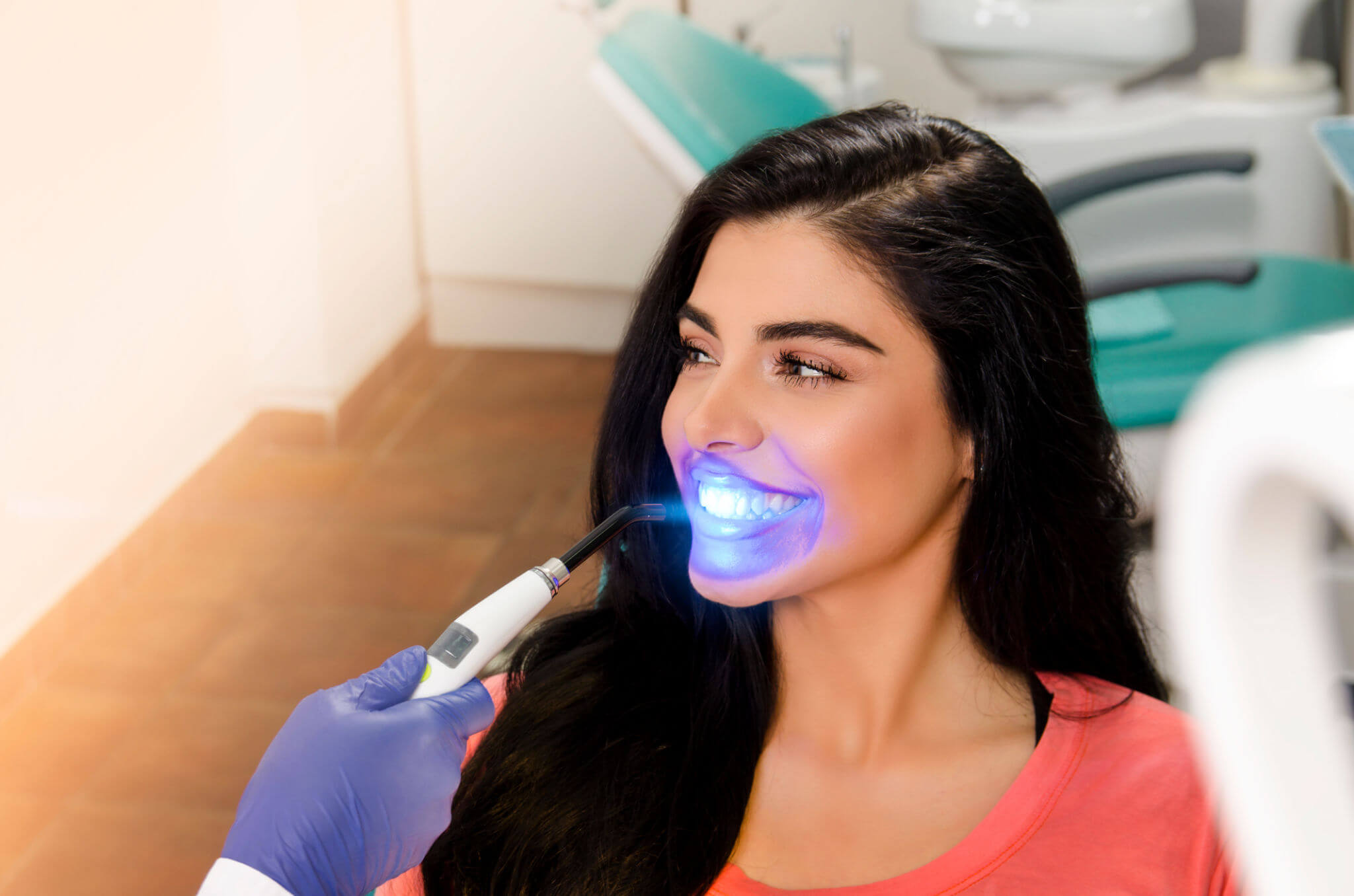 young woman during teeth whitening in new smyrna beach fl